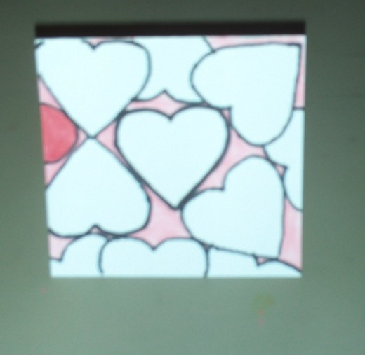 Here I have begun to add red color to one of the side hearts.