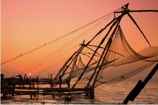 Chinese net fishing boats at sunset.