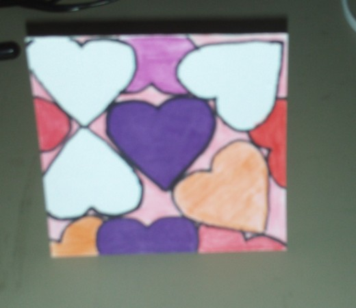 Here I am coloring the purple heart in the center.