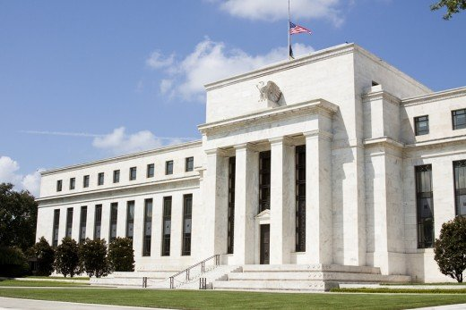 Federal Reserve Bank, issues and then, using third party agencies, buys up the treasury bonds issued by the U.S. Govt. to cover spending. Huh?