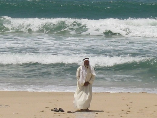 Bedouin elder in prayer on Mediterranean beach