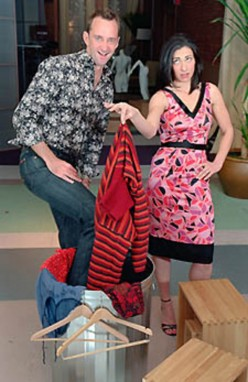 Stacy and Clinton,standing besides one of their fashion victims discards.