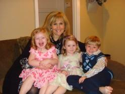 Three little angels sitting on Nana's lap!