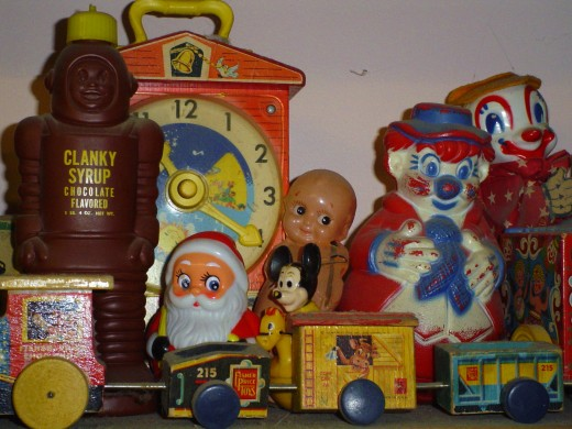 Roly-Polys and Hickory-Dickory clocks, robot chocolate milk syrrup plus a Jack-in-the-box, Kewpie dolls and a Fisher Price train made of blocks, that we'd pull in our tracks on those long summer walks.......
