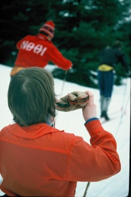 Cross country skier pausing for a drink of water during the Canadian Ski Marathon.