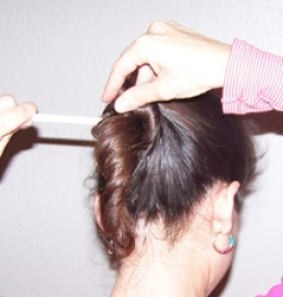 Stick pencil through hair again
