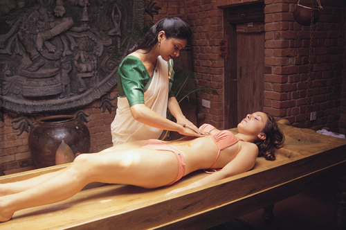 Ayurvedic natural breast massage. Ayurvedic herbs used in massage of breast.
