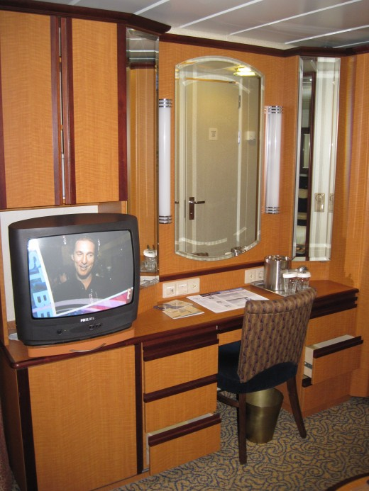 "TV and work station in cabin on Royal Caribbean Cruise Lines' cruise ship ""Jewel of the Seas"""