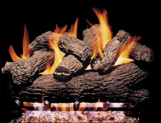 Vented gas log fireplace logs can be stacked and way that makes the best flame pattern because ventilation will pull any fumes out of the area.  Although carbon and creosote is not minimized the hand painted logs will hide discoloration from the flam