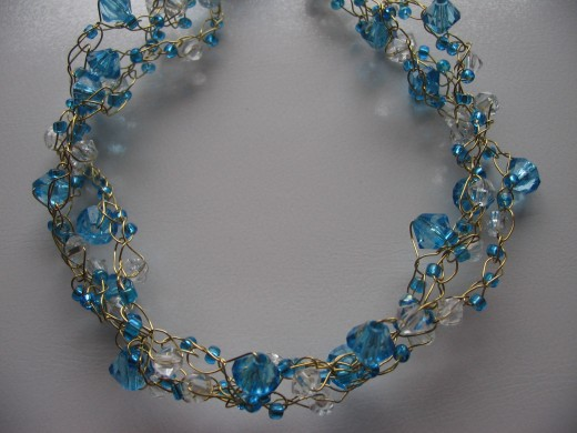 Twist the 3 lengths together for a great effect! This work well as a bracelet or necklace.