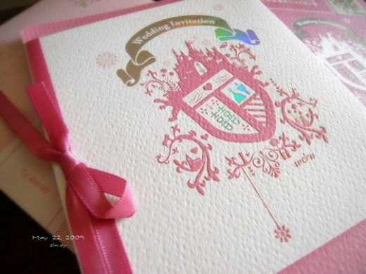 Accents like ribbons and colorful ink add personal style to wedding stationery