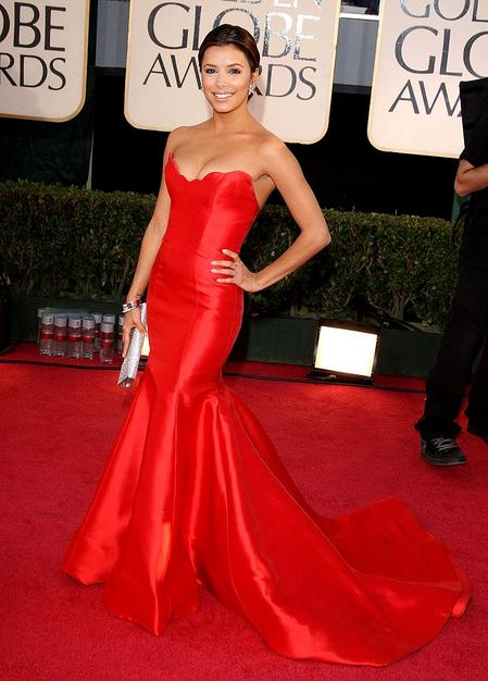 Eva Longoria: This red is gorgeous. Because its sleeveless with a bit of a dip, this evokes a sexy vibe; quick the opposite of Emmy Rossum's above!