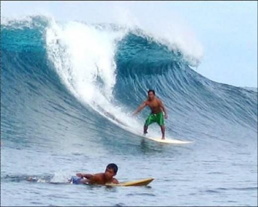 Surfing in Puraran Beach