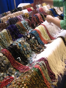 Beads on sale at Tucson Gem Show by an individual who makes his living buying beads from a factory in Hong Kong and selling them at fairs and festivals.