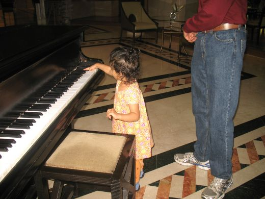 A Baby playing the Piano at the hotel lounge.