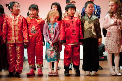 Kids in traditional Chinese New Year garb--happily anticipating lots of angpaos from grown-ups.