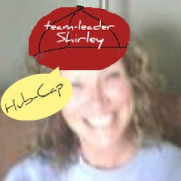 Team leader Shirley lovely, neat and trim in her new for this season wine-red Hub-cap.