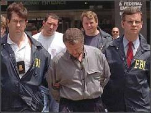 Vyacheslav Ivankov, escorted by FBI agents after arrest in 1995