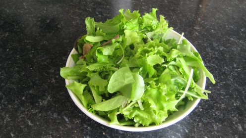Photo: a bowl of freshly picked salad leaves.