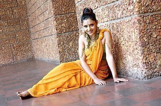 Yashoda in a yellow saree