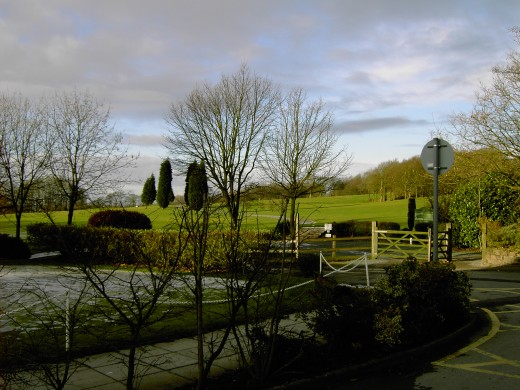 The golf course is accessed from the far side of the car park.