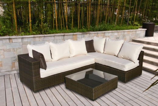 Two chaise loungers attached at the aluminum frame create a sofa set made for beauty and durability outdoors.