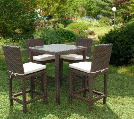 Bar - top height outdoor wicker barstools and table.