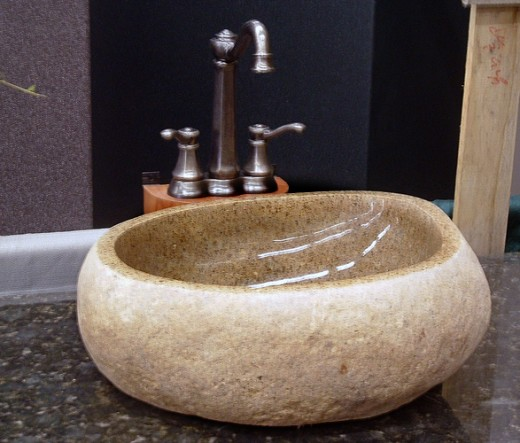 A beautiful stone vessel sink.