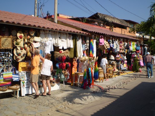 Good for browsing, dining, and a Sol in the shade - the village of Zihuatanejo.