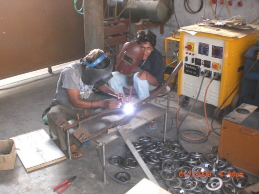 Kartik building chassis of custom chopper pic