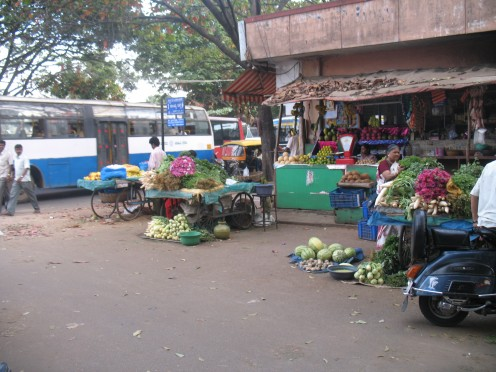 This Many in one shop used by road residents operates right in front of Police & others ON THE ROAD & SIDE WALK.