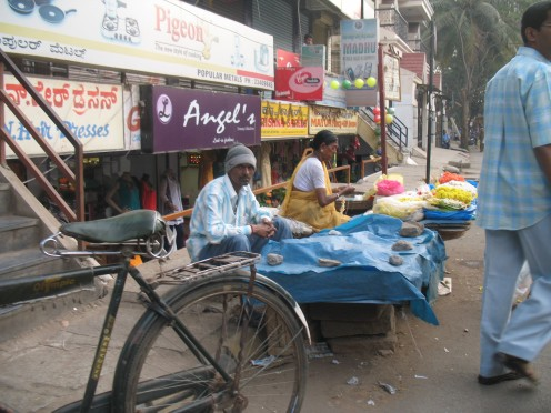 ON NO PARKING PLACE PERMENENT PARKING OF HAWKER SELLING FLOWERS IN THE JUNCTION OF 5 ROADS.