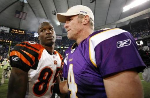 Minnesota Vikings' Brett Favre (4) talks with Cincinnati Bengals' Chad Ochocinco (85) after the second half of an NFL football game Sunday, Dec. 13, 2009, in Minneapolis. The Vikings won 30-10. (AP Photo/Andy King)