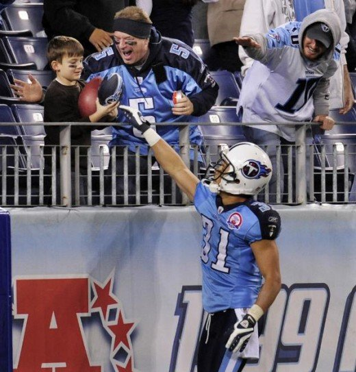 Tennessee Titans cornerback Cortland Finnegan (31) gives the football to a young fan after Finnegan intercepted a pass  Dec. 13, 2009, in Nashville, Tenn.  (AP Photo/John Russell)