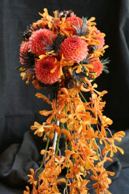 Warm rich colors are traditional for autumn wedding flowers.