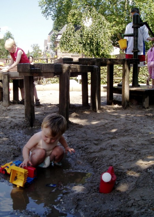 Kid always love to play water and sand