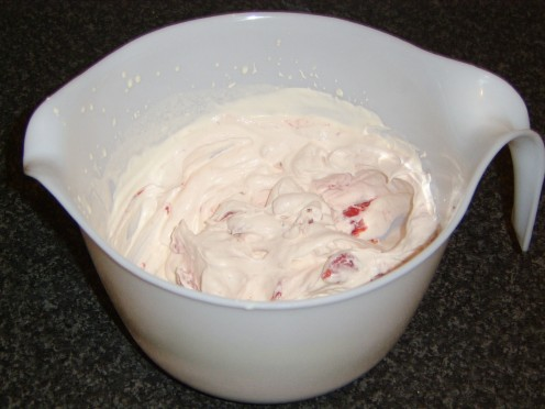 Strawberry Puree Folded in to the Whipped Cream