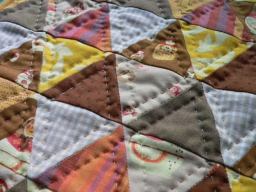 patchwork quilt and hand quilting