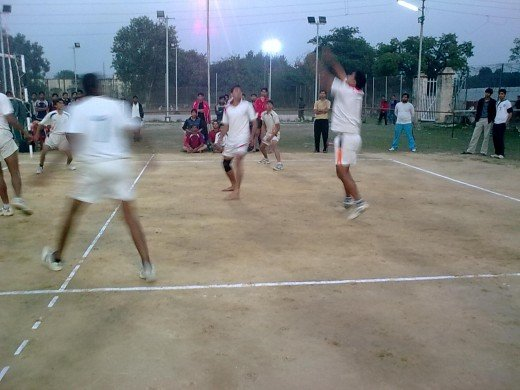 Defending the ball so as to send it to opposite court