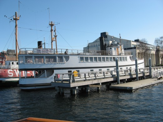 The Virginia V with a steam driven engine at the southern end of Lake Union moored in front of the Wooden Boat Center