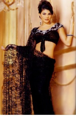 Jackie in a Black Saree showing her Navel