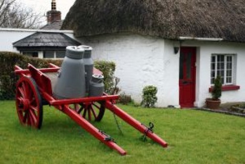 Traditional Irish milk wagon outside a farmhouse.