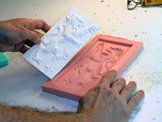 Paper casting being removed from a mold - photo credit: castpaper.com