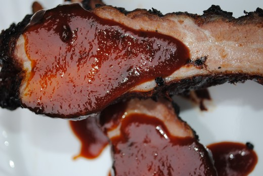 BBQ Pork Spareribs with a little drizzle of slow simemred, homemade BBQ Sauce.