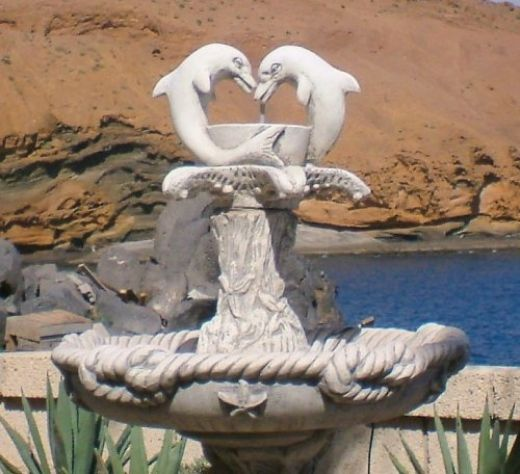 Dolphin fountain outside Flicks bar with the Yellow Mountain in the background.