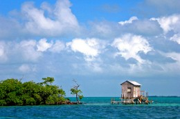 A laid back fishing shack out on the water.