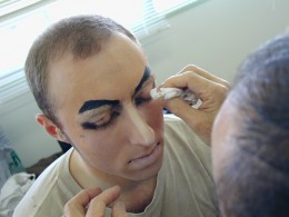 being assisted with the make up