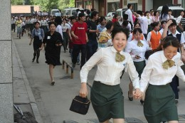 People evacuating after an earthquake.