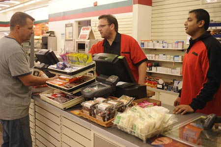 Joseph DePinto, President and CEO of 7-Eleven works the overnight shift at one of his stores.