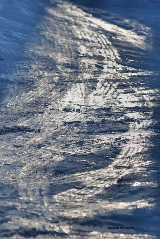 It did turn the driveway tracks into glass-like facets that captured and bounced light.